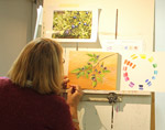 Artist at work in the Mirja Vahala Art Studio, Castlegar, BC